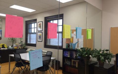 Colorful sheets of paper with positive affirmations hang on the mirrors in M301 March 21. One reads