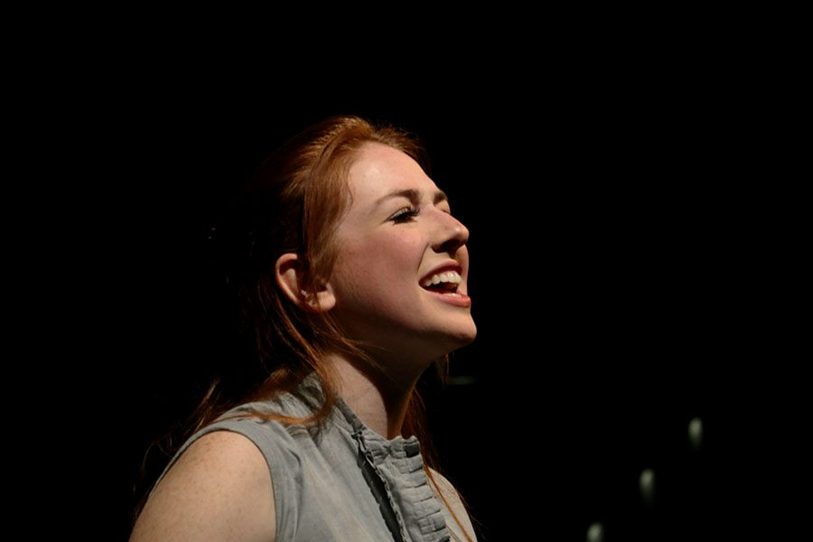"Senior Katie Willnauer sings on stage at Rockhurst High school March 9. Willnauer starred as Bonnie in the musical ""Bonnie and Clyde"". photo by Kate Jones"