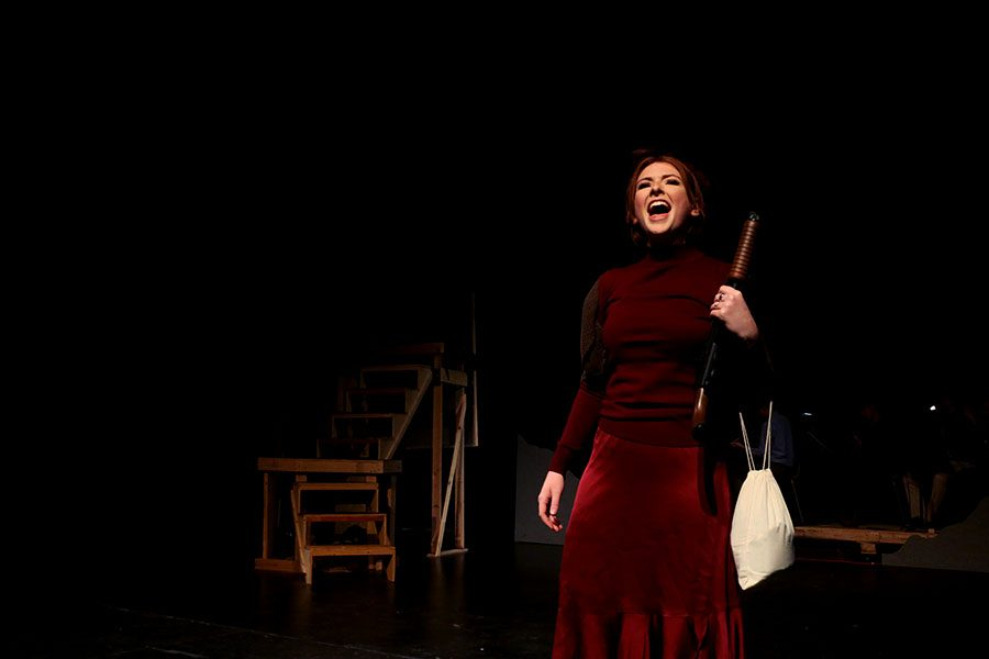 Senior+Katie+Willnauer+sings+in+the+Rose+Theatre%2C+at+Rockhurst+High+School+March+9.+Willnauer+plays+Bonnie+in+the+Rockhurst+High+School+production+of+%E2%80%9CBonnie+and+Clyde%E2%80%9D.+photo+by+Kate+Jones