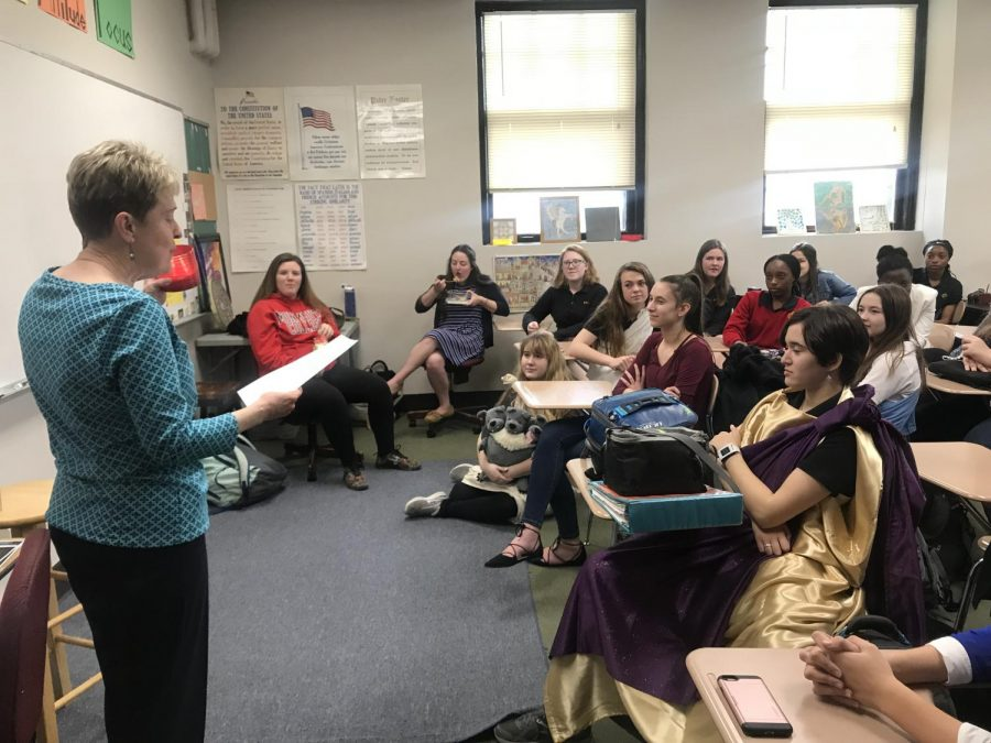 Latin teacher Sue Marquis inducts Latin Honor Society students April 4 in the Latin classroom M201. They were inducted into the Junior Classical League. photo by Trang Nguyen