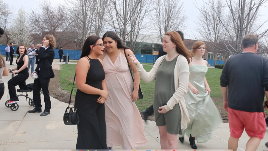 Writer Reagan Penn interviews senior Orion Martinez-Ballard and Anna Kate Powell at Pre Prom on the quad April 13. Seniors gathered in the quad to take pictures before prom. photo by Trang Nguyen