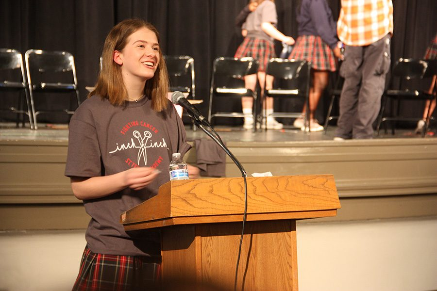 Freshman+Georgia+Winfield+determines+the+%24100+Lulu+Lemon+gift+card+winner+at+the+raffle+in+the+auditorium+April+19.+Winfield+decided+to+donate+to+Pantene+Beautiful+Lengths+rather+than+other+organizations+because+they+give+hair+to+cancer+patients+for+free.+photo+by+Trang+Nguyen