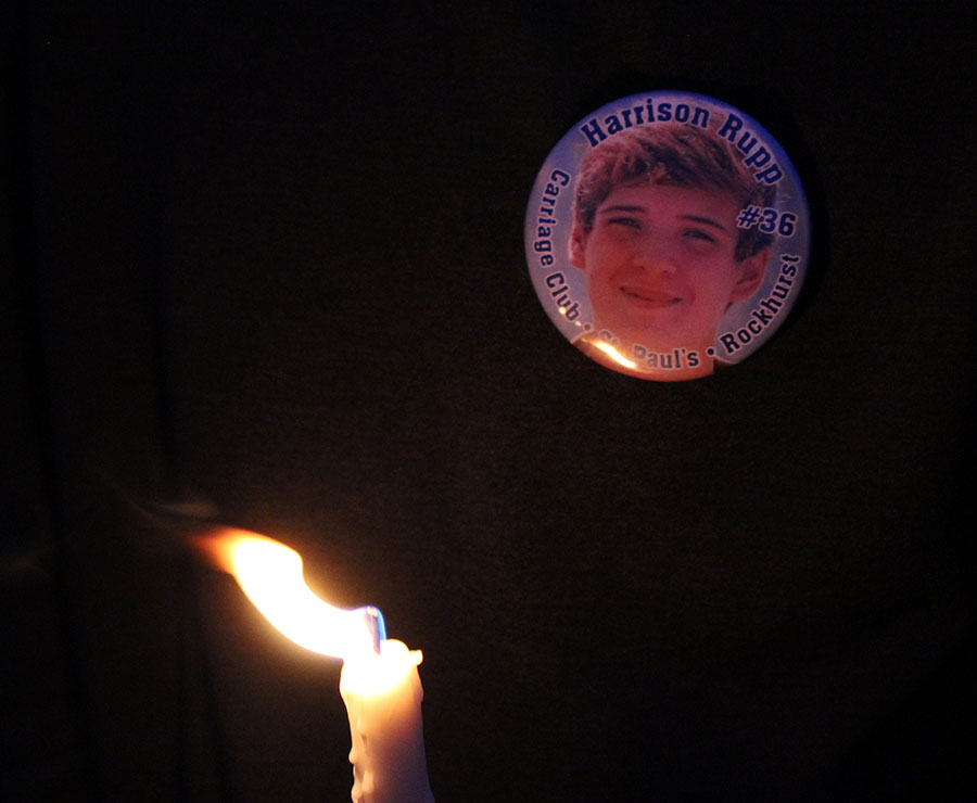 Students wore Harrison Rupp buttons to the candlelight vigil April 10. Countless students and families from Rockhurst, St. Teresa's, St. Paul's and other area schools were there. photo by Maggie Hart