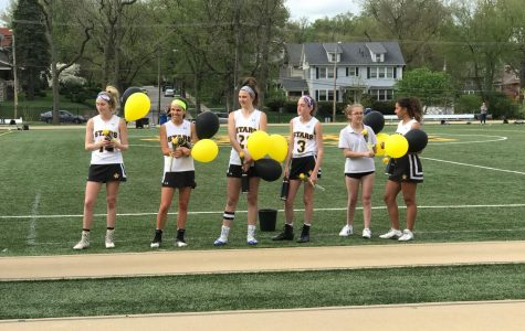The lacrosse team celebrates senior night in an overtime win