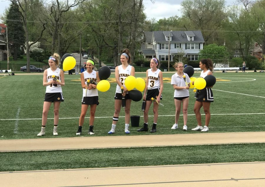 The+teammates+present+their+seniors+with+flowers+and+balloons.+photo+by+Torri+Henry.