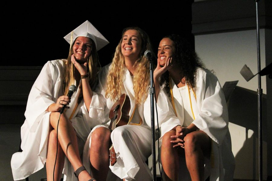 """Seniors Audrey Davis, Claire Wilmot and Isabel Flores perform """"Home"""" by Edward Sharpe and the Magnetic Zeros May 16. Wilmot played the ukulele while the trio alternated singing. photo by Amy Schaffer"""