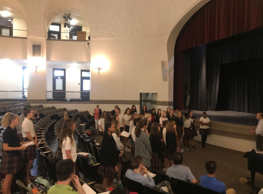 Students auditioning for the fall musical  practice their songs in big groups before small group auditions in the auditorium Aug 28. photo by Tess Jones