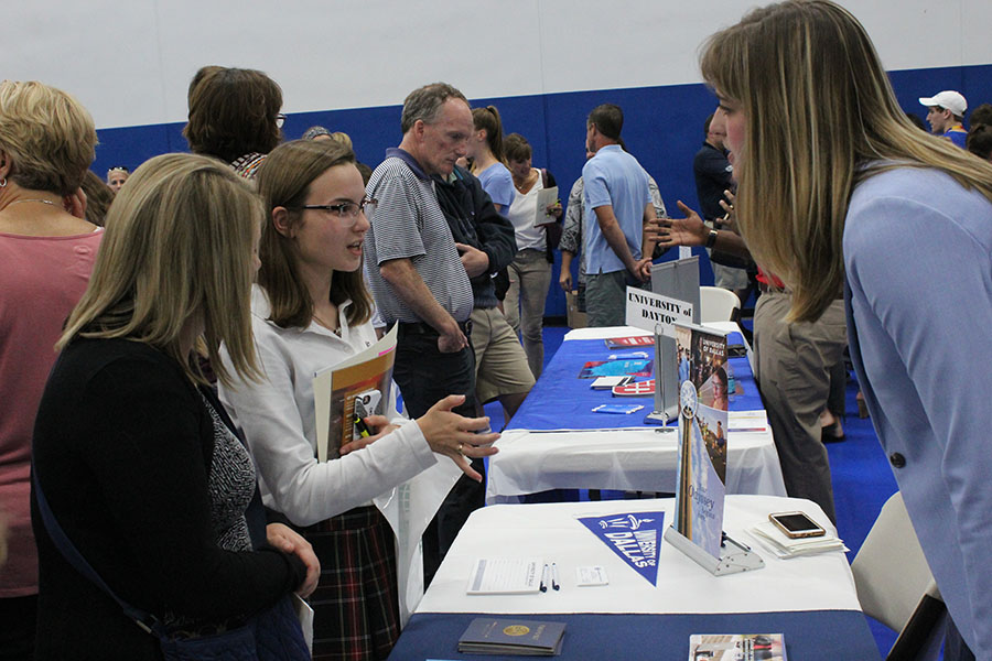 Senior Lauren Daugherty and her mother talk to a college representative, Sep. 13. There were over 130 colleges and universities in attendance. photo by Maggie Hart.