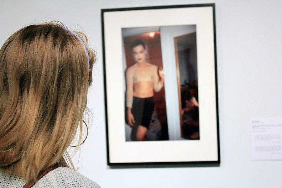 Sophomore Maggie Dodderidge admires a peice by Nan Goldin on Aug. 18. The piece is titled Jimmy Paulette and Tabboo! Undressing, NYC, 1991 (1991). photo by Beatrice Curry