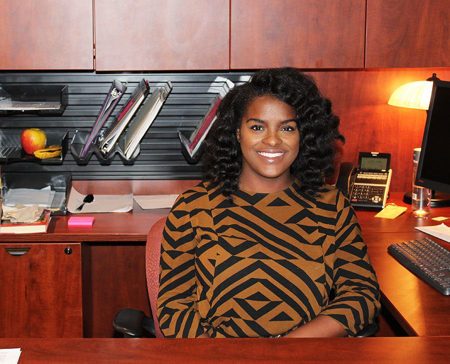 """Brianna Walker smiles in her office in Donnelly Hall Aug. 29. Walker is the first person to hold the title of """"diversity and inclusion director"""" at St. Teresa's. photo by Carmon Baker"""