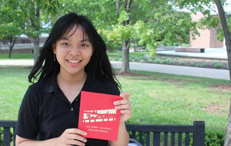 Freshmen Ha Truong poses with a card she bought in Vietnam before coming to Kansas City Aug 31. Truong arrived in the United States over the summer. photo by Maggie Hart