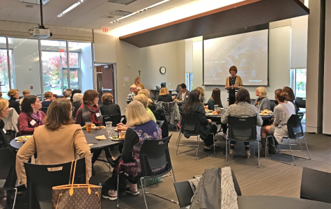 Nan Bone welcomes the Women's Circle of Giving committee to their lunch meeting Oct. 25.