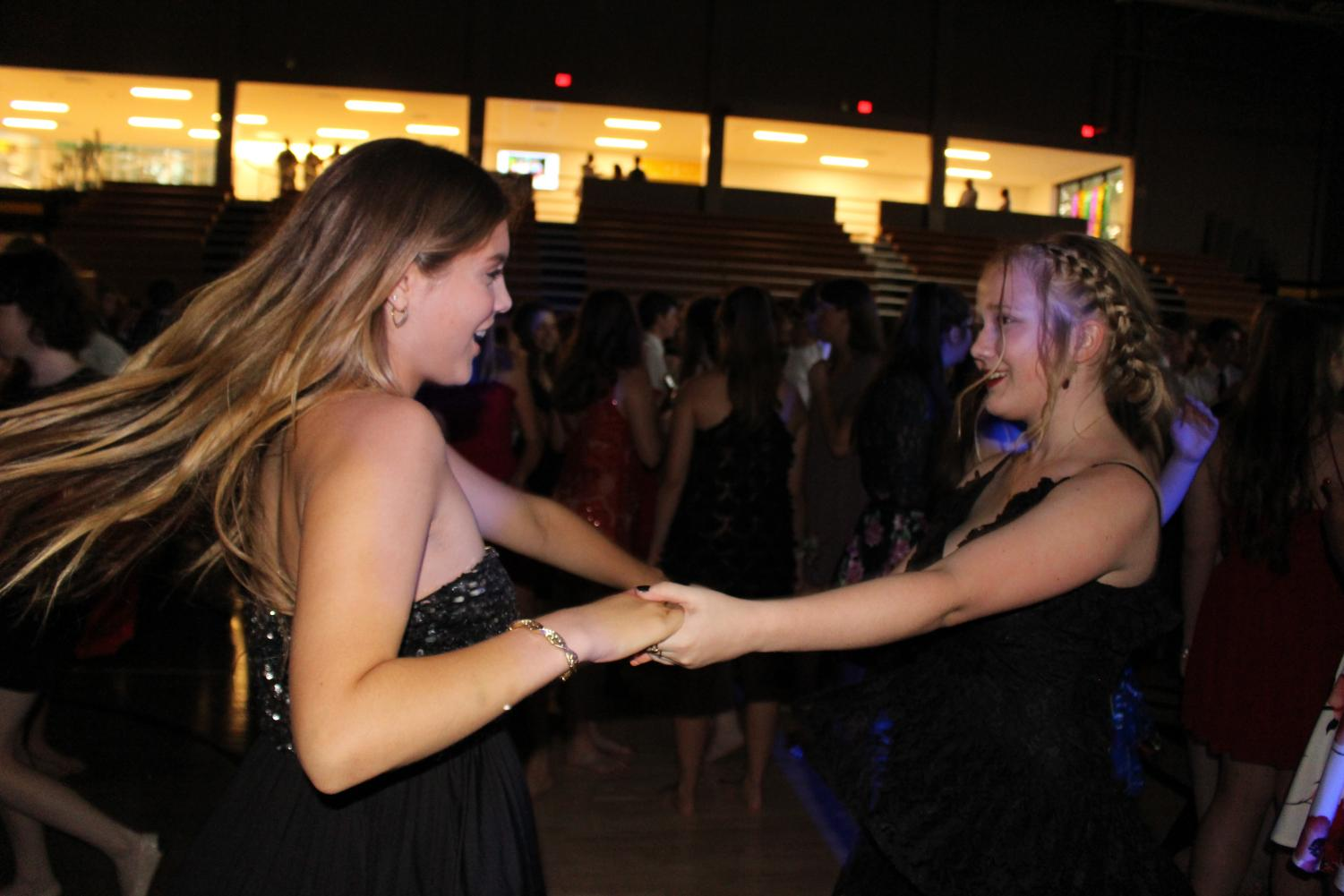 Sophomores Maggie Dodderidge and Mady Mudd dance together at the Teresian dance Sept. 22. photo by Maddie Loehr