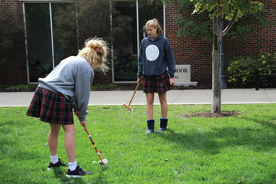 Elise McGhie, left, and Delaney Hupke lead their first meeting of Croquet Club Oct.11. They played croquet in the lawn in front of Windmoor building. photo by Olivia Wirtz