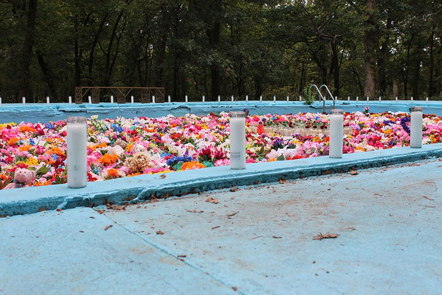 """""""...Called Up"""" is an installation that revamped an abandoned pool Sept. 29. Artist Ebony Patterson made this piece to symbolize the death of childhood and innocence. photo by Maggie Hart"""