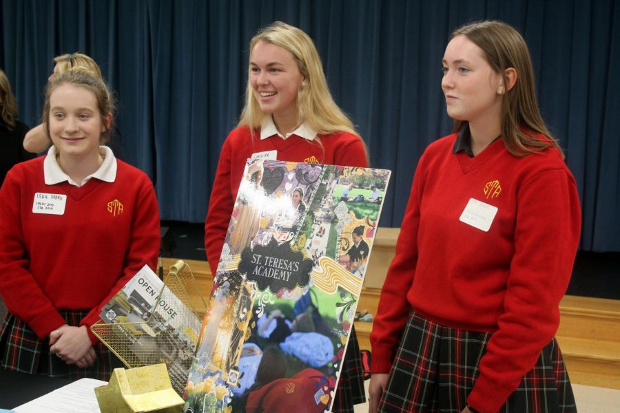 Seniors Leah Dorris, left, Caroline Penner and Mo Burns represent STA at the St. Paul's high school fair Sept. 27. Dorris and Penner are alumnae of St. Paul's. photo by Gabby Staker