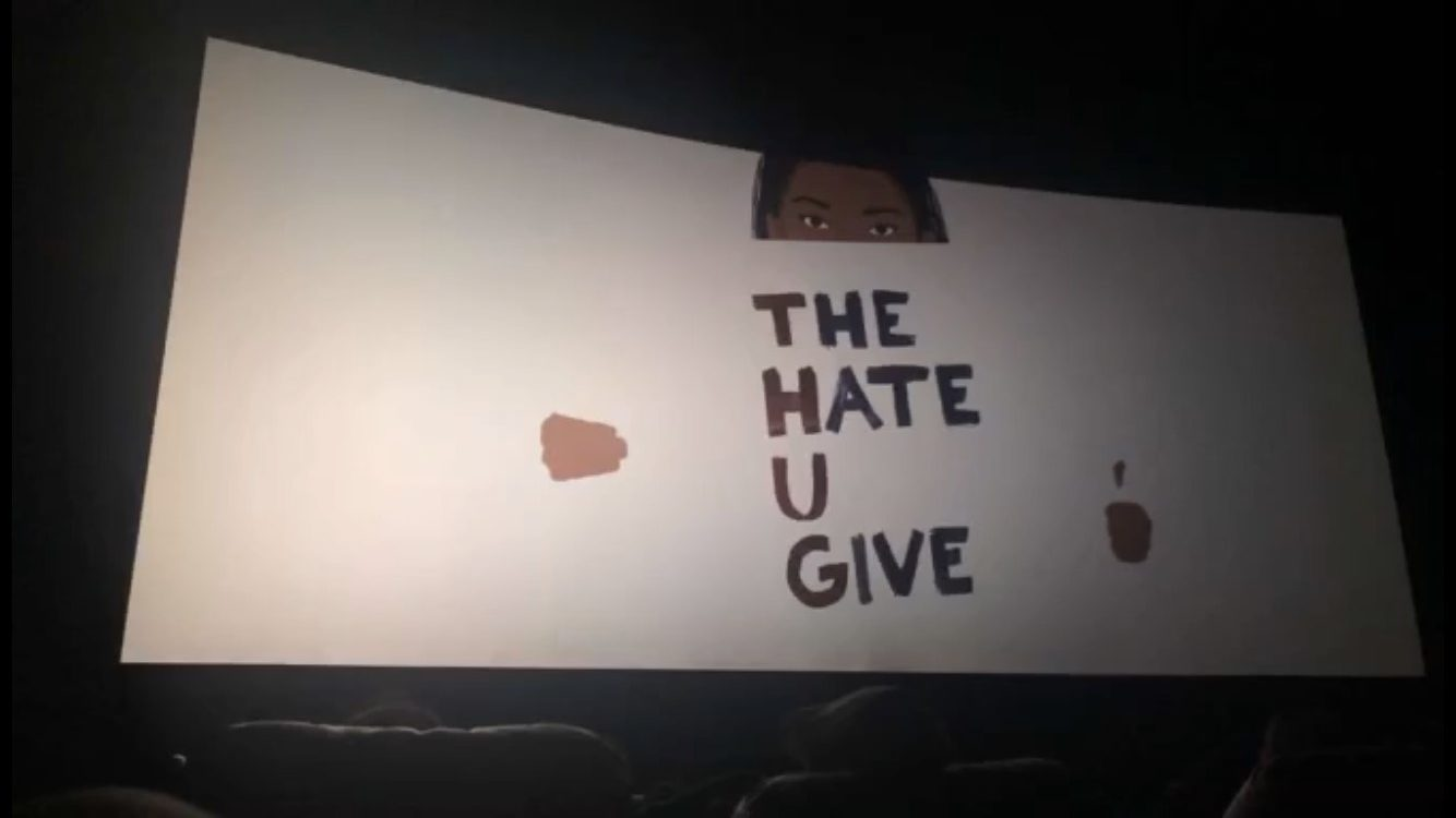 A screen at the AMC Ward Parkway 14 displays the title