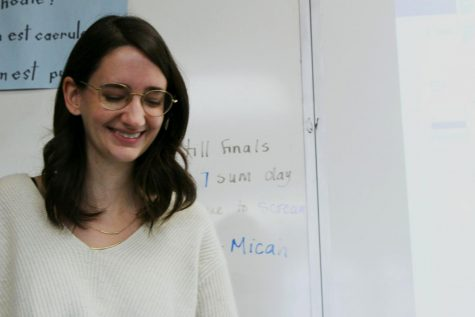 Latin teacher Amanda Hawley laughs at a student