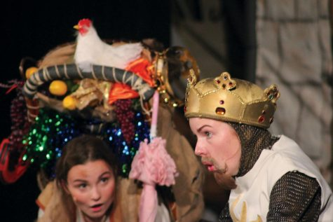 "Senior Margaret Jordahl announces ""Act Three"" as King Arthur in Monty Python's Spamalot Nov. 5. Senior Lauren Daugherty corrects that it is ""Act Two."" photo by Olivia Powell"