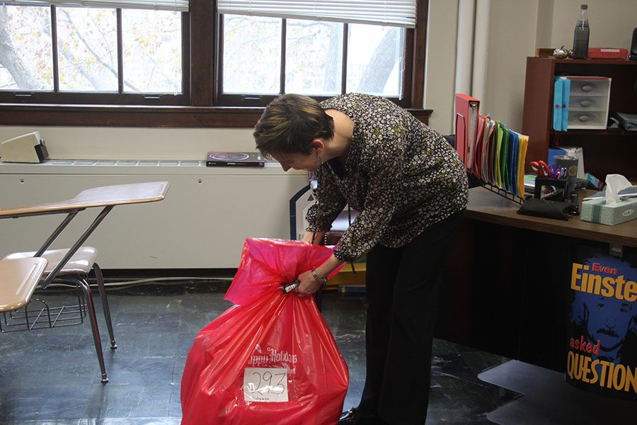 Math teacher Belinda Toma moves her bag of toys that her advisory has collected Dec. 5. Several advisories throughout the school have gathered toys for families who can not afford christmas presents. photo by Beatrice Curry
