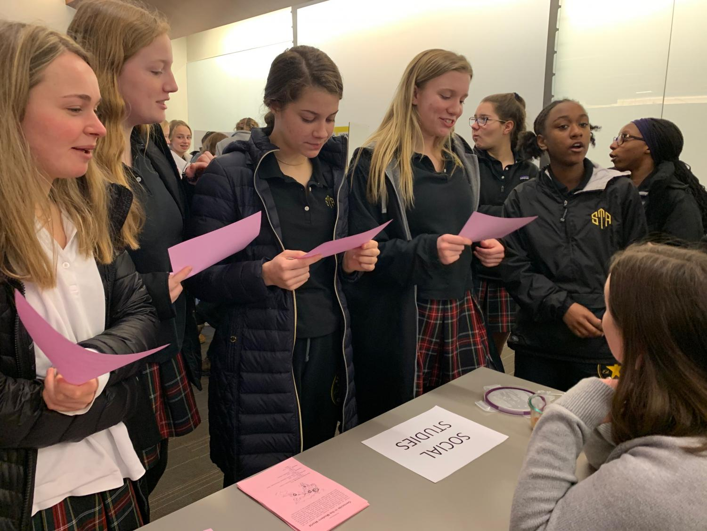 Sophomore Isabel Mayer, left Jackie Hawley, Ava FitzGerald,  Ellie Fuemmeler, Oliva Baker and Kayla Smocks talk to Ms. O'Flaherty about doing Psychology next year.