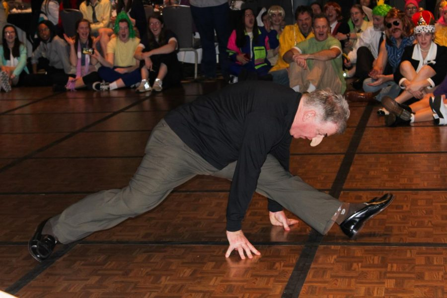 """Mark Thompson falls into the splits to celebrate a dance-off win Jan. 27. Thompson wore a Dr. Doofenshmirtz costume from """"Phineas and Ferb."""" photo by Amy Schaffer"""