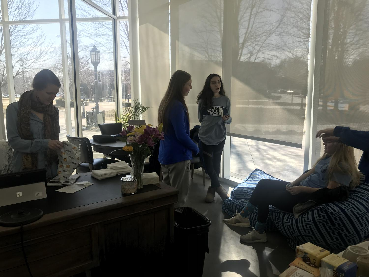 Mrs. Arredondo and students Holly Phalen, Sasha Blair and Claire Wunder have a discussion about faith Feb.1. photo by Kendall Lanier