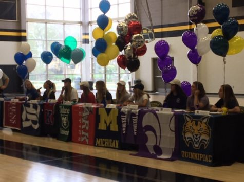 Seniors sit during their signing ceremony in the gym April 17. Ten seniors this year were a part of the signing ceremony. photo by Annabelle Meloy