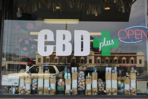 Various products and Easter decorations line the window of CBD+ April 6. CBD can be used for such issues as pain, inflammation, anxiety and depression. photo by Mary Massman.