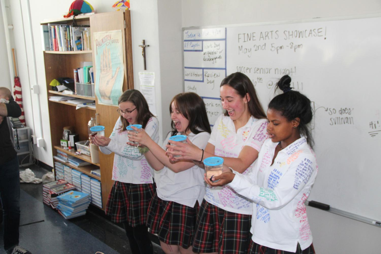 Seniors Lauren Daugherty from left, Megan Gallagher, Grace Berghoff, and Erris Pierson get beta fish from their advisory May 3. Daughtery, Bergoff, and Pierson are in the Meyer advisory. photo by Tess Jones