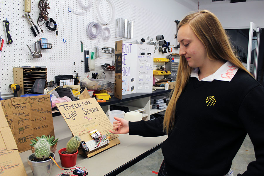 Senior Macy Bauers explains her project for an engineering class May 2. Bauers is one of the seniors who received their STEM certificate this year. photo by Carmon Baker