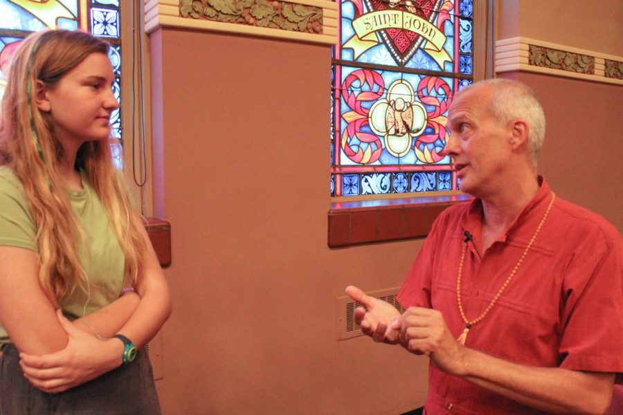 Junior Kelly Ann Greene, left, and Temple Buddhist Center director Victor Dougherty talk about the topics discussed during the service Sept. 8. Dougherty spoke about what emotions mean and how to handle them. photo by Cara Barone