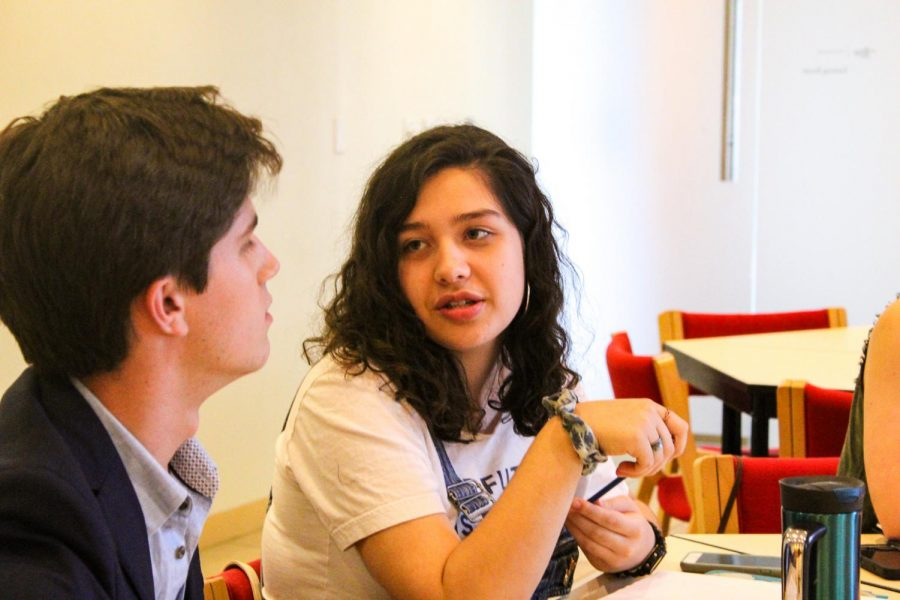 Nelson-Atkins teen council member Mariel Pepitone shares ideas with fellow teen council member Drake Potts during a meeting Sept. 4. Pepitone and Potts are both seniors at Pembroke Hill. photo by Beatrice Curry