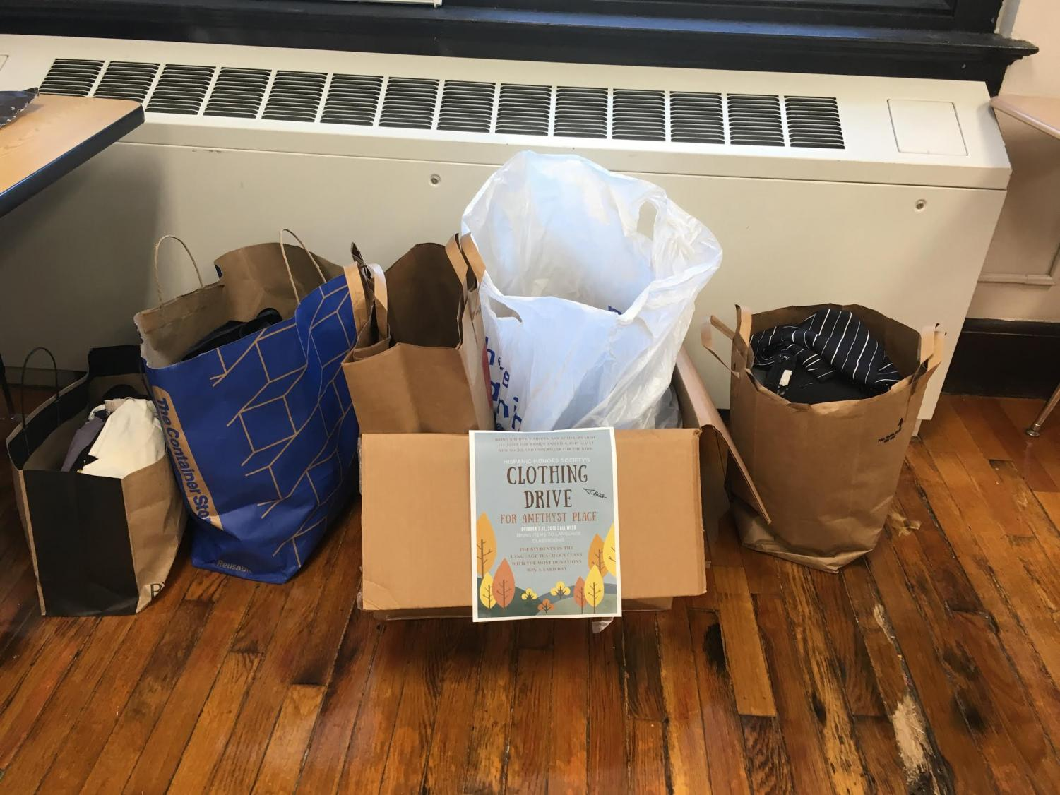 A collection bin for the Hispanic Honor Society clothing drive sits in a Spanish classroom Oct. 7. The donations from the drive will be donated to Amethyst Place. photo by Carmon Baker
