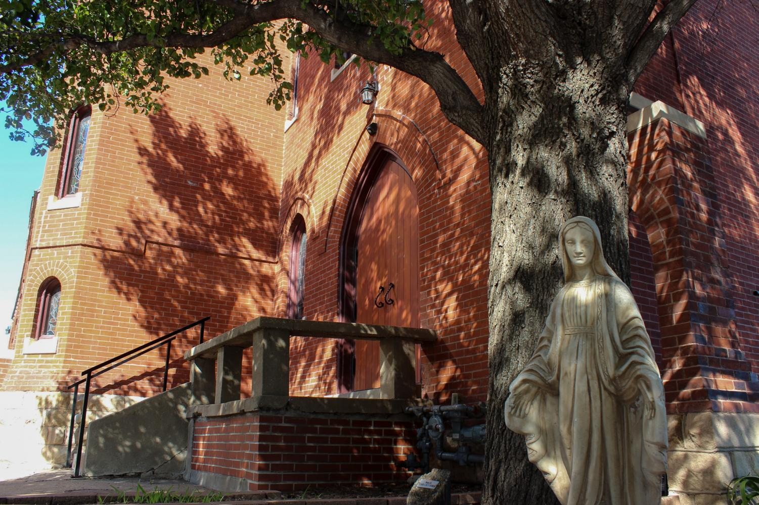 A statue sits outside of St. Mary's Church Aug. 23. The Episcopalian church was built in 1886 and supposedly haunted by Father Jardine, who started the church. photo by Ella Norton