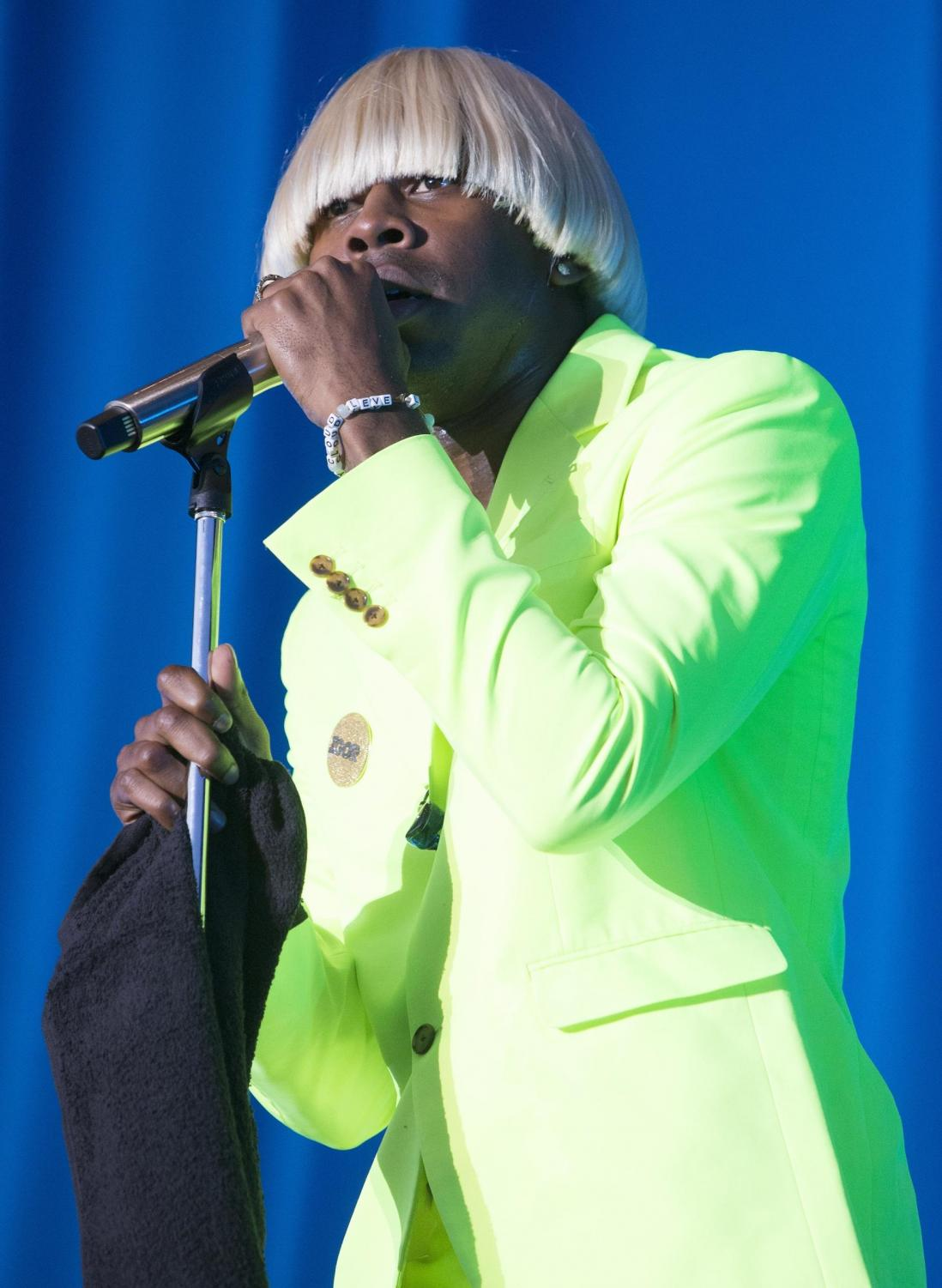 """Tyler the Creator dressed in his """"IGOR"""" outfit performing on stage. photo courtesy of News Tribune Service"""