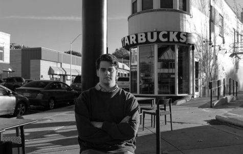 Rockhurst High School senior Sam Kidder sits outside of Starbucks Nov. 12. Kidder has taken action in the community and has started his own non-profit called Not Alone KC. photo illustration by Becca Speier