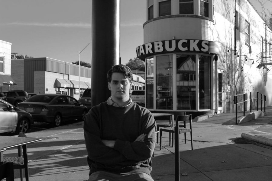 Rockhurst High School senior Sam Kidder sits outside of Starbucks Nov. 12. Kidder has taken action in the community and has started his own non-profit called Not Alone KC. photo illustration by Becca Speier