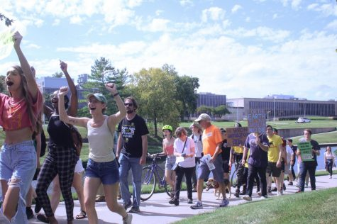 Protesters march at the Global Climate Strike Sept. 20. The march started at James A Theis Park and ended at the UMKC campus. photo by Anna Ronan