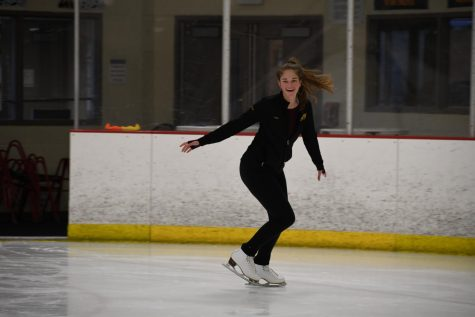 Senior Emma Marsh smiles during her skating practice Nov. 19. Marsh practices with friends and team members five days a week after school. photo by Claudia Benge