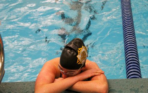 Senior Brooke Fallis catches her breath after her 50-meter freestyle race Jan. 25. Fallis realized she was iron deficient last year. photo by Katie Massman