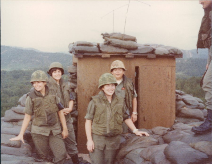Mary Cox stands next to fellow nurses in a demilitarized zone in 1978. photo courtesy of Mary Cox