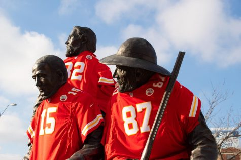 "The Kansas City Pioneer Square Movement statue in Westport is dressed with the three ""captain"" jerseys: Patrick Mahomes, Travis Kelce and Tyrann Mathieu Jan. 20. The town was very excited for the previous night's win. photo by Lily Sage"