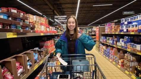 Senior Katherine Kallas poses in an Aldi shopping lane Jan. 12. Kallas has followed a vegan diet since 2017. photo by Amy Schaffer
