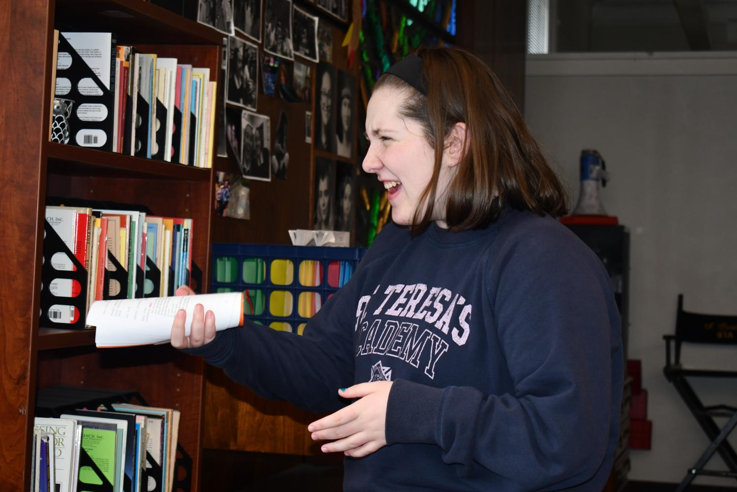 - Junior Gracie Swanson laughs as she practices her lines Jan. 27. Swanson will appear in STA's upcoming production of