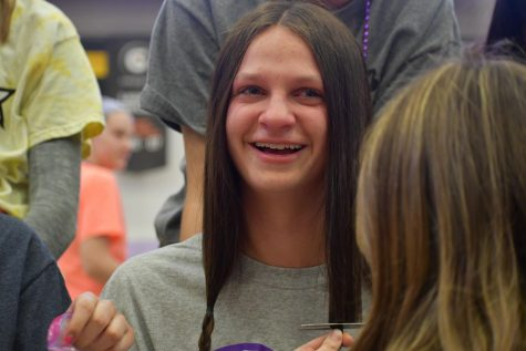 Grayson Walton becomes emotional when her hair was first cut Mar. 6.  Junior Georgia Winfield mentions how it would be an emotional and brave moment for all girls. photo by Becca Speier