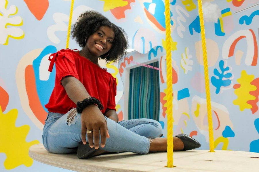Senior Faith Andrews-O'Neal poses for one of her senior pictures at Wonder Wonder, a photography studio in Oak Park Mall Sept.28. Andrews-O'Neal is motivated  to do great things in her school community because of how much support she has received these past years. photo courtesy of Amy Schaffer