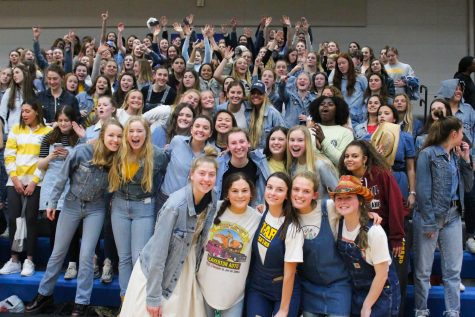 STA students cheer in the bleachers at the Rockhurst High School vs. STA volleyball game held at Rockhurst Feb. 24. The theme for the student section was denim. photo courtesy of Liv DeSantis