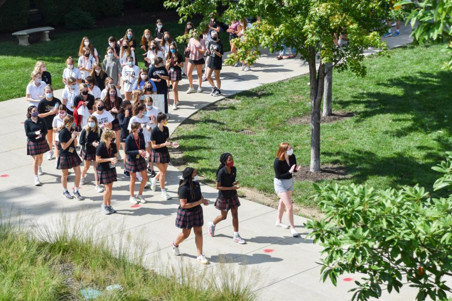 Over 140 students gathered to march around the quad for eight minutes and 45 seconds, signifying the amount of time George Floyd was suffocated by a police officer until his death Sept. 3. The Black Student Coalition put together this march. photo by Claire Smith