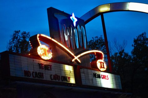 "The Twin Drive-In Theater sign lights up showing what movies it is playing Sept. 26. ""Mean Girls"" and ""Tenet"" were the last two movies the theater showed this year. photo by Lucy Doerflinger"